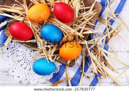 Easter eggs on color wooden background - stock photo