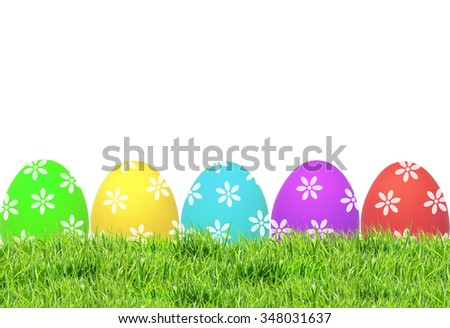 Easter eggs on green grass isolated on white background - stock photo