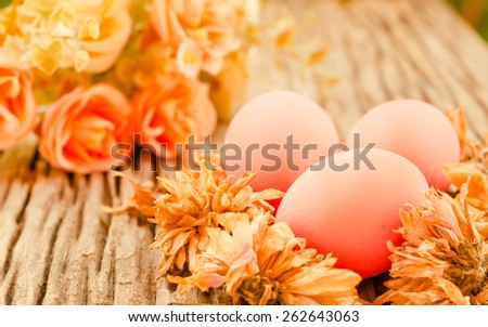 Easter eggs on natural wooden table in style vintage retro soft focus. - stock photo