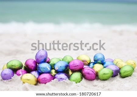 easter eggs on ocean beach  - stock photo