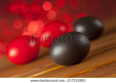 Easter eggs on red background - stock photo