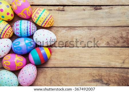 Easter eggs on wooden background with space - stock photo