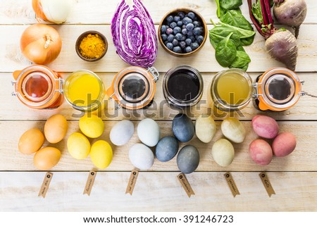 Easter eggs painted with natural egg dye from fruits and vegetables. - stock photo