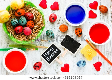 Easter eggs painting colorful background. Homemade crafts preparation on Happy Easter holiday top view - stock photo