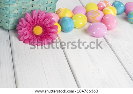 Easter Eggs with Daisy and Basket in a row at top of frame on white board background with room or space for copy, text. Horizontal  - stock photo