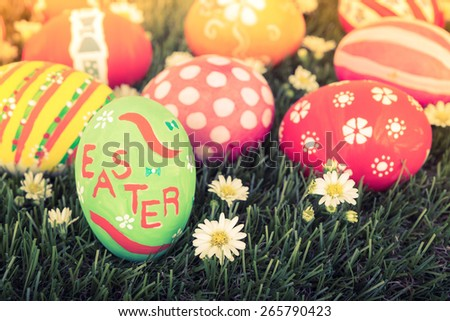 Easter Eggs with flower on Fresh Green Grass - stock photo