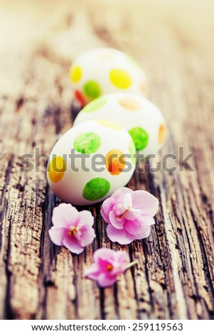 Easter eggs with flowers / easter holidays spring background - stock photo
