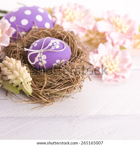 Easter Eggs with Nest on Fresh Green Grass - stock photo