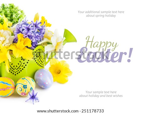 Easter eggs with spring flowers in watering can. Isolated on white background - stock photo