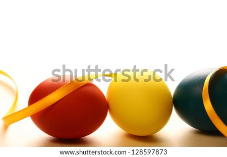 Easter eggs with yellow ribbon - stock photo