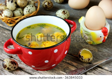 Easter festive soup with egg yolks on old wooden table, selective focus - stock photo