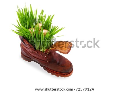 Easter golden eggs in old shoes.  Happiness  you can be found everywhere, just look around ourselves - stock photo