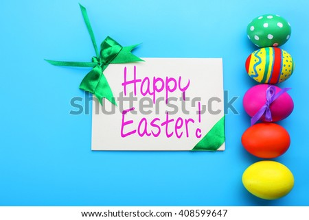 Easter greeting card. Painted eggs on blue background - stock photo