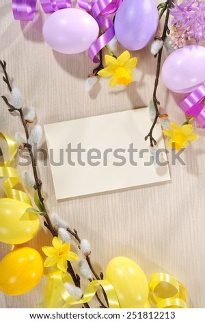 Easter greeting card with copy space, easter eggs and narcissus  - stock photo