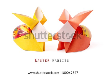 Easter handmade bunny rabbits with painted egg on a white background - stock photo