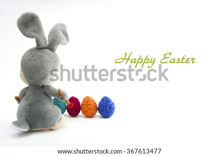 Easter Handmade Bunny with Eggs in Basket. Happy Easter. - stock photo