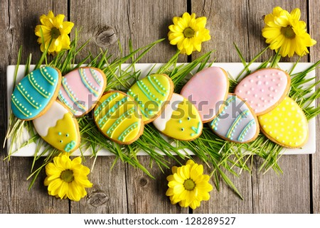 Easter homemade gingerbread cookie over wooden table - stock photo