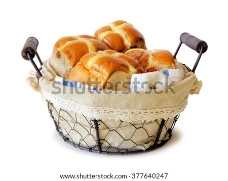 Easter Hot Cross Buns in a vintage wire basket isolated a white background - stock photo