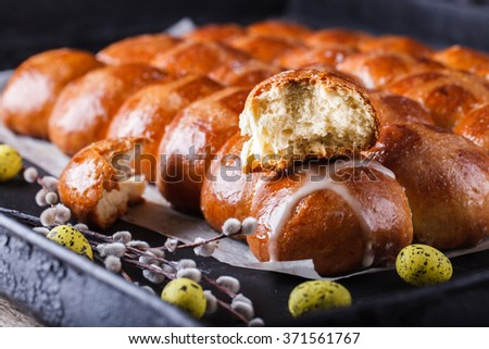 Easter Hot Cross Buns on a dark background.selective focus. - stock photo