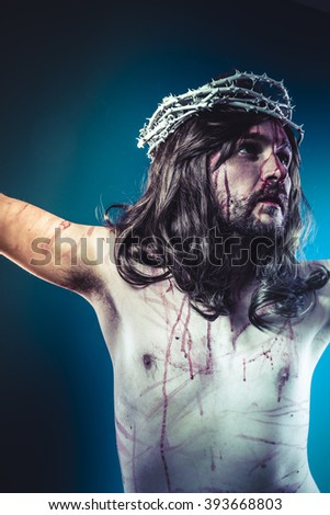 Easter jesus christ, son of god representation with crown of thorns and wounds of Calvary skin - stock photo