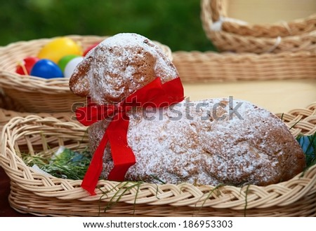 Easter lamb cake and colored easter eggs - stock photo