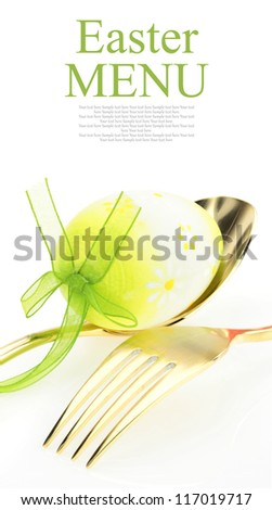 Easter menu. Spoon with fork and Easter egg - stock photo