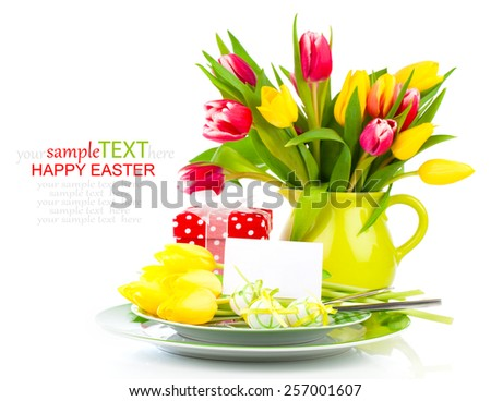 Easter place setting with tulip flower on white background - stock photo