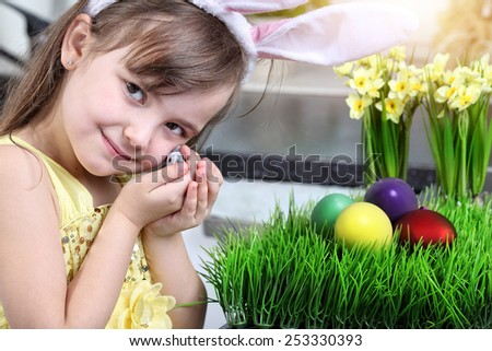 Easter preparation - youth beautiful cheerful girl - stock photo