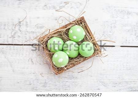 easter quail eggs decoration on wooden background - stock photo