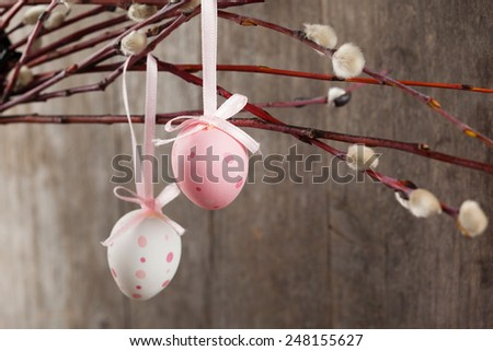 Easter still life of decorative pink eggs over old wooden background, selective focus - stock photo
