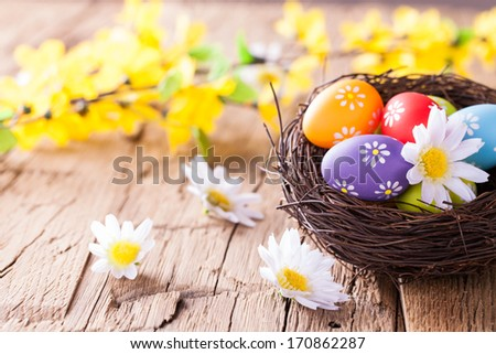 Easter still life with traditional decorative eggs in nest - stock photo
