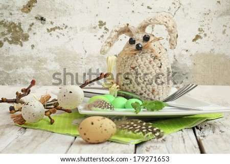 easter table setting. Knife with fork and Easter egg - stock photo
