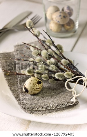 Easter table setting  with quail eggs, willow branches - stock photo