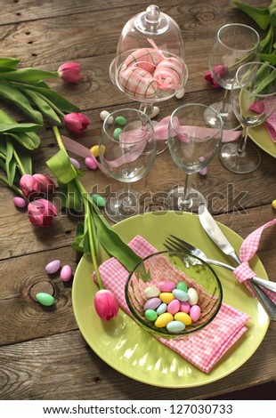 Easter table setting with tulips - stock photo