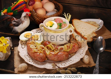 easter white borscht with eggs and roasted sausage on rural wooden background - stock photo