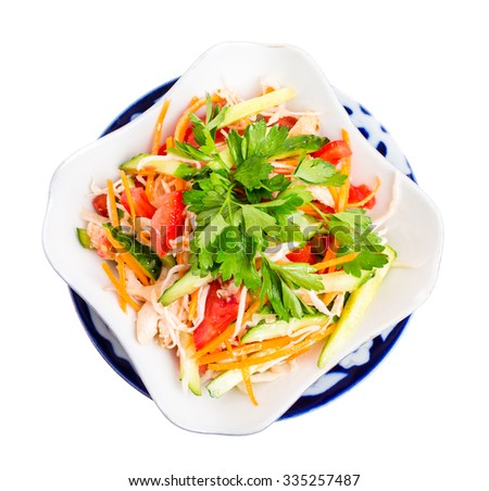 Eastern chicken salad with grated carrot and fresh vegetable mix. Isolated on a white background. - stock photo