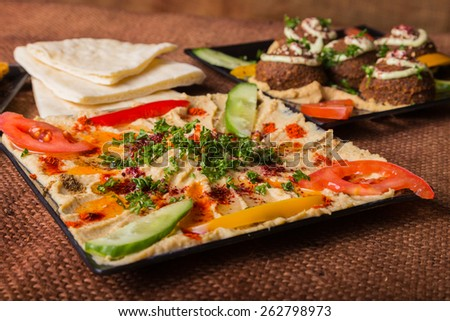 Eastern food. Snack. Hummus. Hummus with meat and greens and bread. Arab food. - stock photo