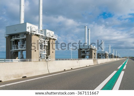 Eastern Scheldt storm surge barrier at the Zeeland coast in the Netherlands. This largest Delta Work of a series of dams is designed to protect the Netherlands from flooding from the North Sea - stock photo