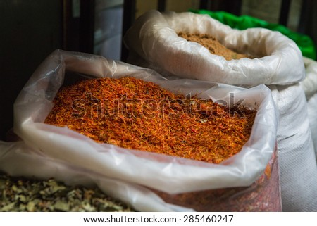 Eastern spices in a bag on a market. - stock photo