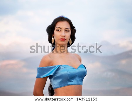 Eastern style portrait of a beautiful girl at sunset - stock photo