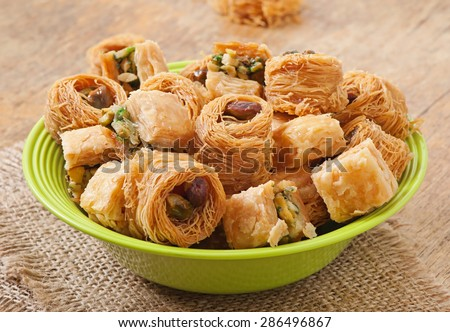Eastern sweets on plate - stock photo