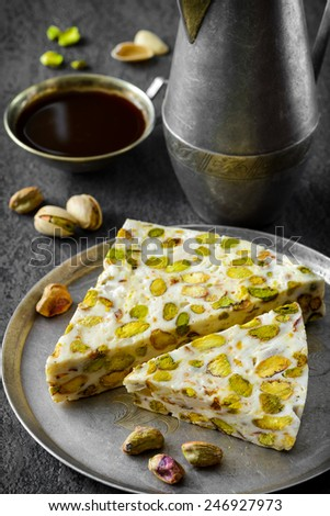 eastern traditional dessert with nuts on gray background. Selective focus - stock photo