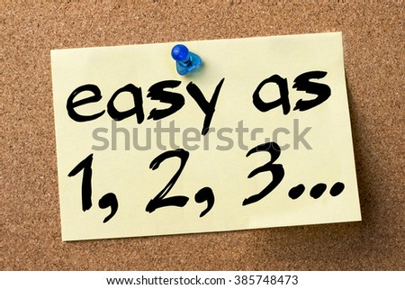 Easy as 1, 2, 3... - adhesive label pinned on bulletin board - horizontal image - stock photo