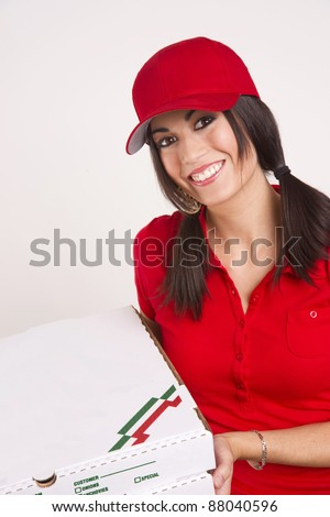 Easy Going Pizza Delivery Woman Holds Food Boxes in Red Uniform - stock photo