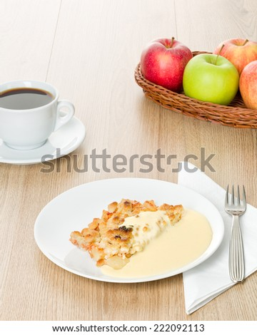 Easy layout of an apple crumble dessert with vanilla custard. - stock photo