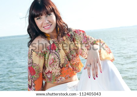 Easy summer: young caucasian woman enjoying summer time near the shore - stock photo