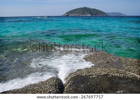 Easy surf washes coastal stones. Andaman Sea - stock photo