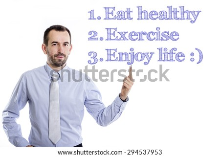 Eat healthy, exercise, Enjoy life  Young businessman with small beard pointing up in blue shirt - stock photo