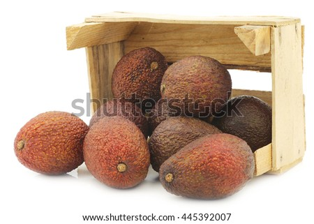 Eat ripe avocado's in a wooden crate on a white background - stock photo