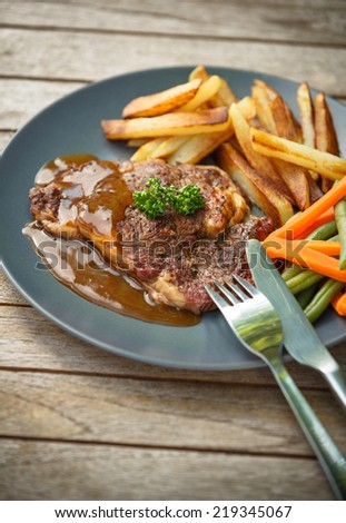 Eating a beef steak - stock photo